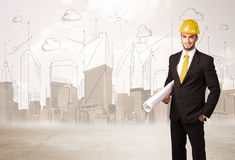 Business engineer planing at construction site with city background stock photos