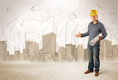 Business engineer planing at construction site with city backgro royalty free stock images