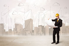Business engineer planing at construction site with city backgro Stock Image