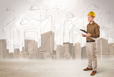 Business engineer planing at construction site with city background stock image