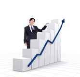 Business entrepreneur with a graphics chart Royalty Free Stock Photos