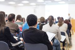 Woman giving presentation on business conference. Royalty Free Stock Image