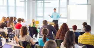 Speaker giving presentation on business conference. Business and entrepreneurship symposium. Speaker giving a talk at business meeting. Audience in conference Royalty Free Stock Photography