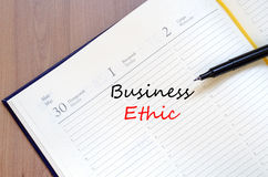 Business ethic write on notebook. Business ethic text concept write on notebook Royalty Free Stock Images