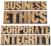 Business ethics. And corparate integrity - isolated text in letterpress wood type printing blocks Stock Photography