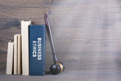 Business Ethics. Wooden gavel and books in background. Law and justice concept Royalty Free Stock Photos