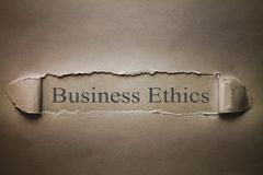 Business Ethics words on torn paper. stock images
