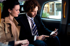 Business execitives in taxi cab Stock Photography