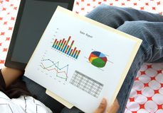 Business executive analyzing corporate data and reports. Business executive preparing presentation on corporate financial data and reports using  a tablet and Royalty Free Stock Photography