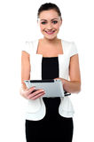 Business executive browsing on tablet device Stock Images
