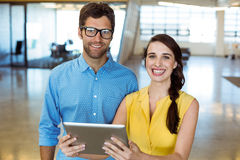 Business executive and co-worker holding digital tablet Royalty Free Stock Photos