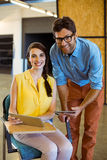 Business executive and co-worker holding digital tablet Royalty Free Stock Image