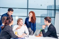 Business man making presentation at office. Business executive delivering presentation to his colleagues during meeting or in-house business training Stock Image