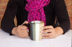 Business executive having a cup of coffee. In her office or workplace Stock Photography