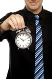 Business executive holding alarm clock Stock Photography