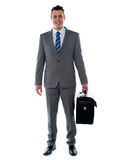 Business executive holding briefcase Royalty Free Stock Photos