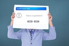 Business executive holding confirmation box sign over face Royalty Free Stock Photo