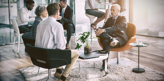 Business executive interacting with each other. In office Royalty Free Stock Image