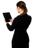 Business executive operating touch pad Stock Images