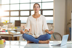 Business executive performing yoga Royalty Free Stock Photography
