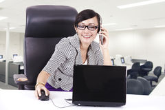 Business executive on phone with laptop Royalty Free Stock Photos