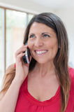 Business executive on phone while smiling Stock Image