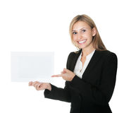 Business executive pointing at an empty billboard Royalty Free Stock Image