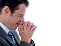 Business executive praying to god Stock Photography