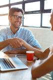 Business executive shaking hands with coworker Royalty Free Stock Photography