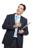 Business executive smiling while writing notes Stock Photos
