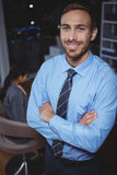 Business executive standing with arms crossed Royalty Free Stock Image