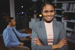 Business executive standing with arms crossed Stock Photography