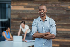 Business executive standing with arms crossed in office royalty free stock images