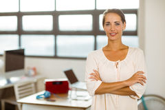 Business executive standing with arms crossed in office Royalty Free Stock Photography