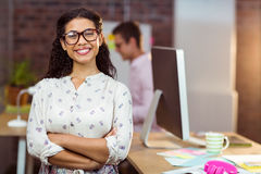 Business executive standing with arms crossed in office Royalty Free Stock Image