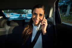 Business executive talking on mobile phone in car Royalty Free Stock Photography