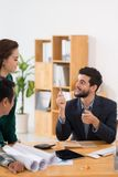 Business executive talking to colleagues Royalty Free Stock Photo