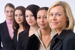 Business executive team. Group of business people is standing in a row, the boss is standing in the front Stock Photography