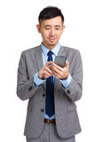 Business executive texting on cell phone Royalty Free Stock Photo