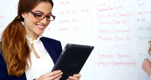 Business executive using digital tablet in meeting stock footage