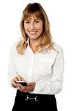 Business executive using her mobile Stock Photo