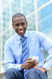 Business executive using his smart phone Royalty Free Stock Photo