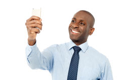 Business executive using mobile phone Royalty Free Stock Photography