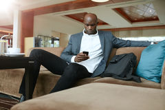 Business executive waiting in hotel lobby Stock Photography