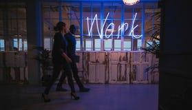 Business executive walking through office corridor Royalty Free Stock Photos