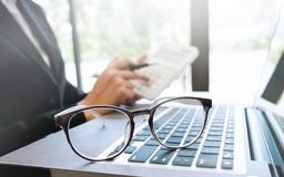 Business executive working on calculator selective focus on eyeglasses. stock images