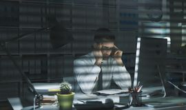 Business executive working late at night royalty free stock image