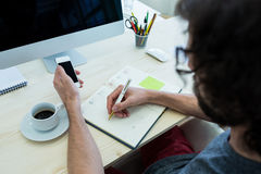 Business executive writing in diary Royalty Free Stock Photo
