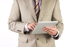 Business executivebrowsing internet. Corporate executive and businessman checking working on a tablet with wifi connectivity Stock Images