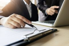 Business executives analysis data document with accountant at workplace.  royalty free stock photography